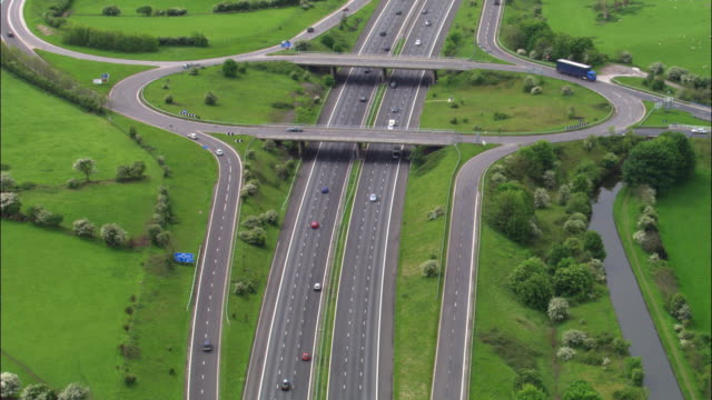 Aerial over vehicles on M6 motorway junction, Lancashire, UK