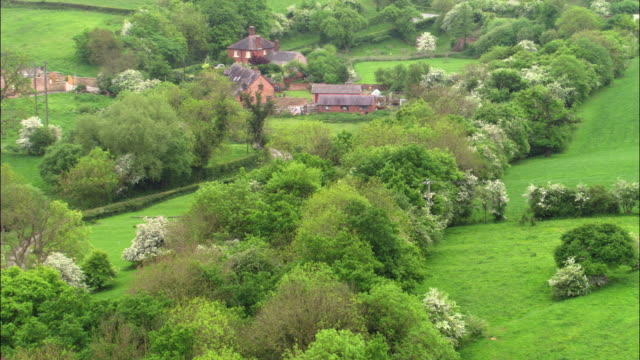 Aerial over village and hedgerows, Shropshire, UK