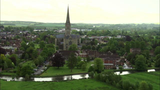 stockvideo's en b-roll-footage met aerial over water meadows towards salisbury cathedral, wiltshire, uk - wiltshire