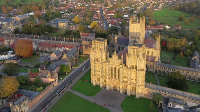 aerial over wells and wells cathedral, seat of the bishop of bath and wells, somerset, england - anglican stock videos & royalty-free footage