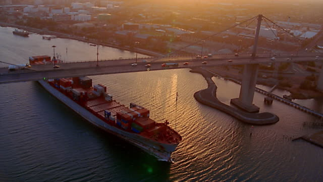 aerial over west gate bridge / melbourne docklands - freight transportation stock videos & royalty-free footage