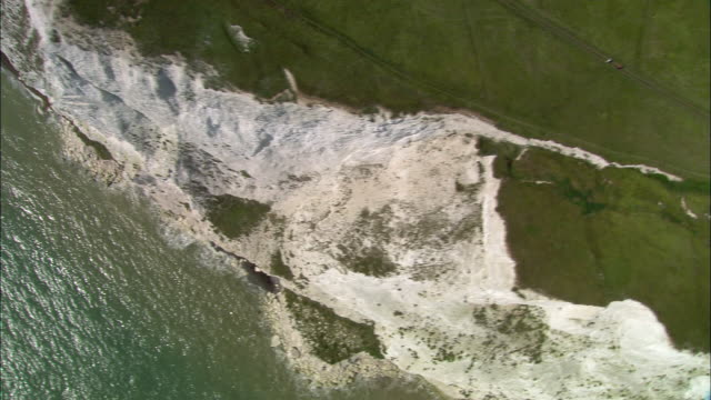 aerial over white cliffs of dover overlooking english channel / kent, england - kent england stock videos & royalty-free footage