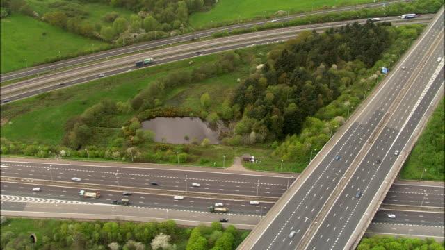 aerial over wildlife refuge between motorways, uk - motorway junction stock videos & royalty-free footage