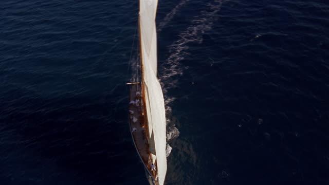 Aerial over yacht sailing on ocean