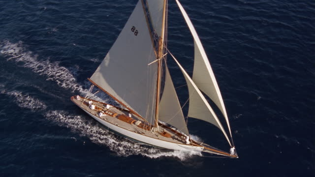 aerial over yacht sailing on ocean - nautical vessel stock videos & royalty-free footage