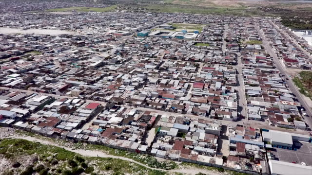 aerial overhead a township in south africa - slum stock videos & royalty-free footage