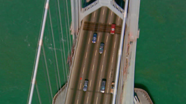 aerial overhead bay bridge with traffic / tilt up to hills in background / san francisco, california - 1991 stock videos and b-roll footage