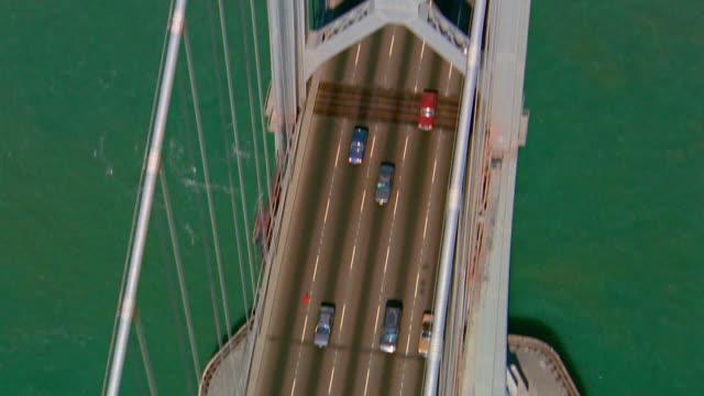 stockvideo's en b-roll-footage met aerial overhead bay bridge with traffic / tilt up to hills in background / san francisco, california - 1991