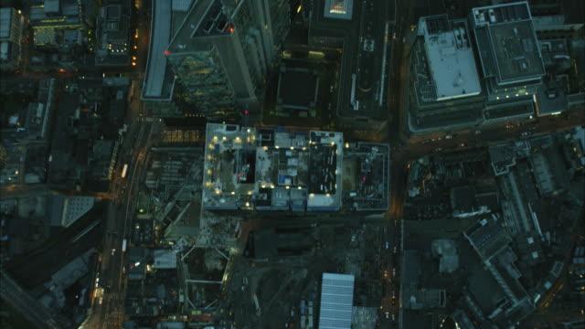 aerial overhead dusk view of illuminated london buildings - twilight stock videos & royalty-free footage