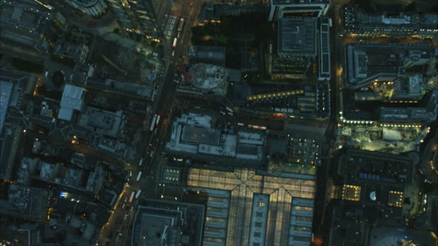 aerial overhead dusk view of illuminated london buildings - sir norman foster building stock videos & royalty-free footage