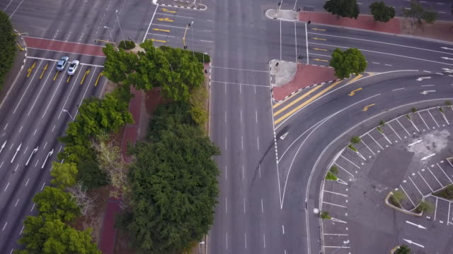 aerial overhead empty street intersection - strada vuota video stock e b–roll