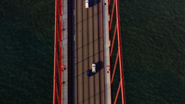 Aerial overhead point of view close up Golden Gate Bridge with traffic / San Francisco, California
