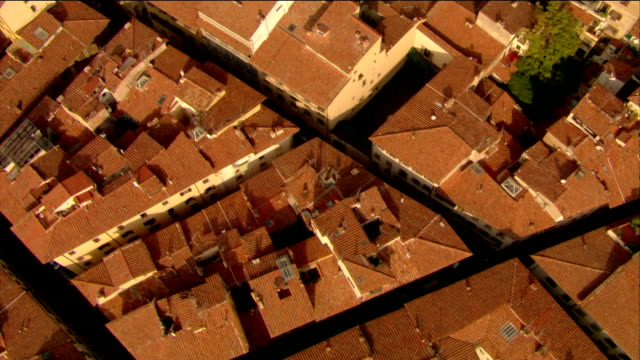 aerial overhead shot of rooftops / florence, italy - florenz stock-videos und b-roll-filmmaterial