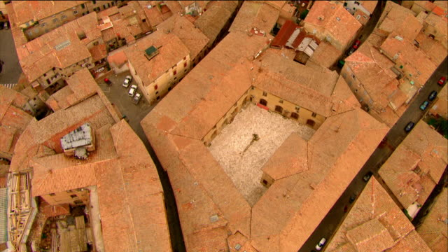 aerial overhead shot of rooftops in siena to piazza del campo to church / siena, italy - piazza del campo stock videos and b-roll footage