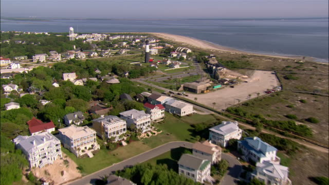 aerial overhead tybee island beach and houses/ lighthouse and compound/ georgia - 2006 stock videos & royalty-free footage