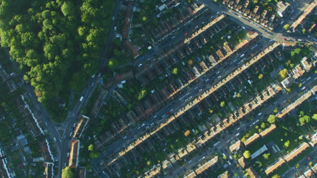 aerial overhead view at sunrise london residential neighborhood - twilight stock videos & royalty-free footage