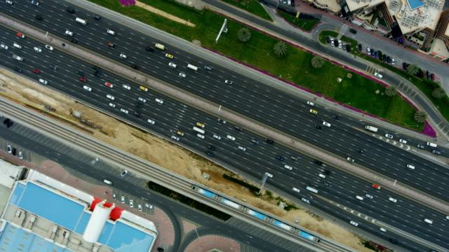 Aerial overhead view city highway commuter traffic Dubai