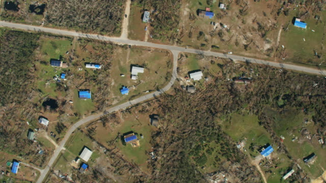 Aerial overhead view hurricane damaged rooftops Florida Panhandle
