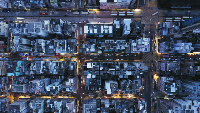 aerial overhead view of city at night with buildings and streets in kowloon, hong kong - aerial stock videos & royalty-free footage