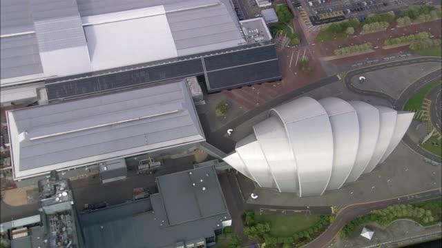 aerial overhead view of clyde auditorium (the armadillo) adjacent to secc / glasgow, scotland - スコットランド グラスゴー点の映像素材/bロール
