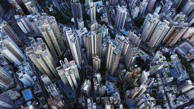 aerial overhead view of hong kong high rise skyscrapers and residential district - crane shot stock videos & royalty-free footage