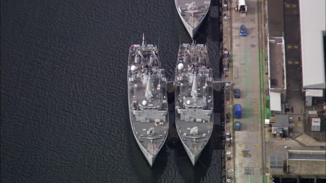 Aerial overhead view of Royal Navy ships docked at Faslane Naval Base / Scotland