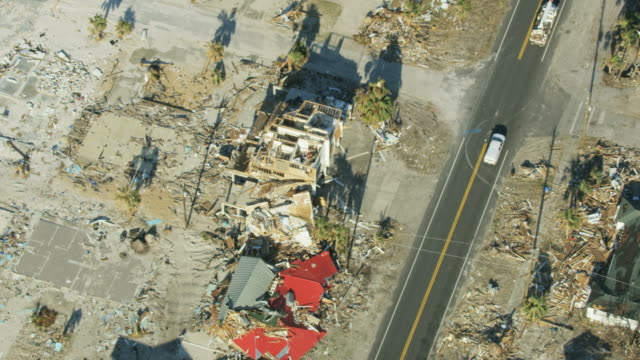 aerial overhead view utility trucks aftermath of hurricane - destruction stock videos & royalty-free footage