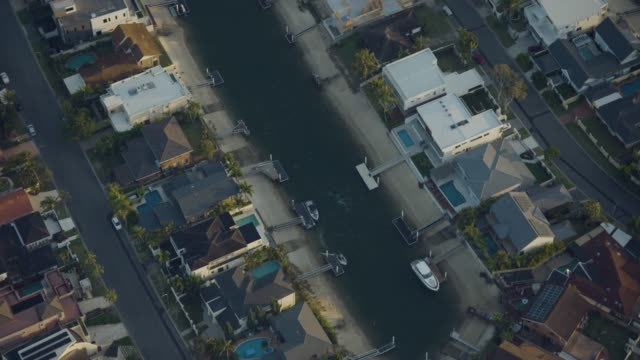 aerial overhead view waterfront homes gold coast queensland - coastal feature stock videos & royalty-free footage