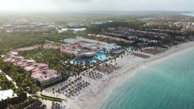 aerial: overlooking buildings in punta cana - dominican republic stock videos and b-roll footage
