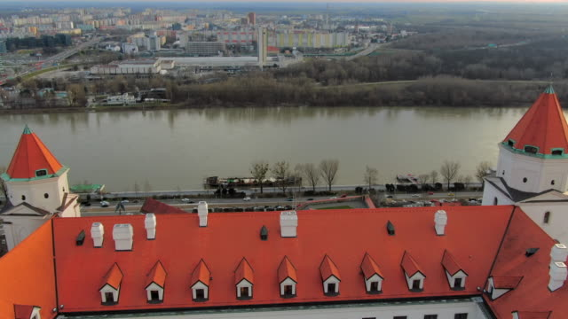 aerial: overlooking city, danube river and bratislava castle in slovakia - dacherker stock-videos und b-roll-filmmaterial