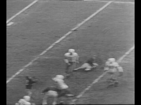 aerial packed rose bowl stadium for annual rose bowl game / montage long pass down the field, run for yardage; run for touchdown / excited fans... - 1940 1949 video stock e b–roll