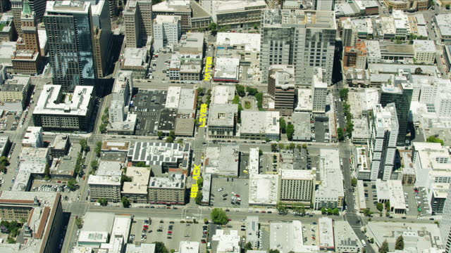aerial painted oakland street with black lives matter - オークランド点の映像素材/bロール