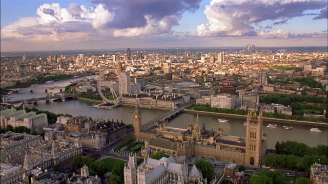 aerial palace of westminster, westminster bridge and london eye on thames - river thames stock videos & royalty-free footage