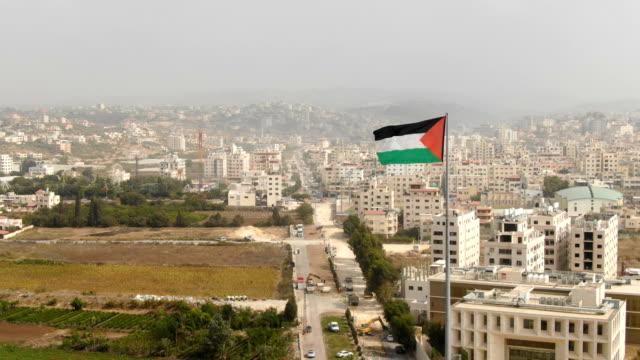 aerial/ palestine flag, tulkarm palestinian city - palestinian stock videos & royalty-free footage