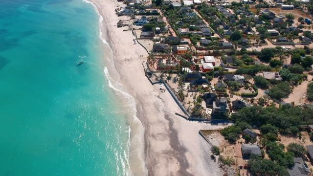 aerial pan: beach and village in cabo pulmo mexico - tropical climate stock videos & royalty-free footage