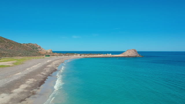 aerial pan: beautiful beach in cabo pulmo mexico - sea of cortez stock videos & royalty-free footage