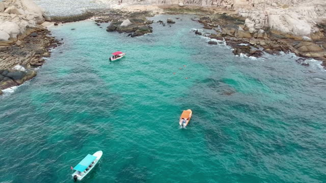 Aerial Pan: Boats in the Sea and Snorkeling in Cabo Pulmo Mexico