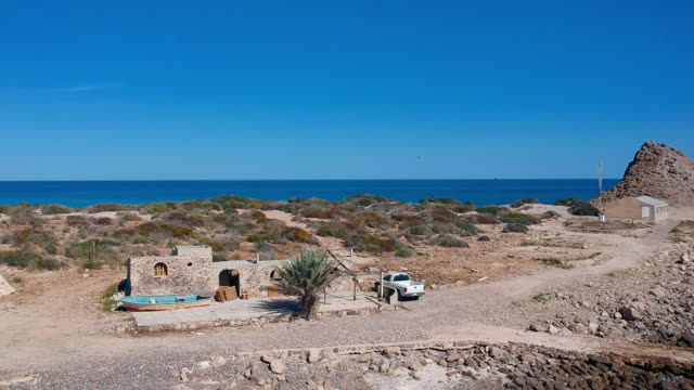 aerial pan: desert house in cabo pulmo mexico with a boat - baja california peninsula stock videos & royalty-free footage