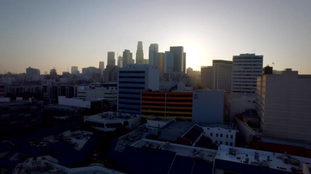 aerial pan dolly up to reveal downtown los angeles skyline - staples centre stock videos & royalty-free footage