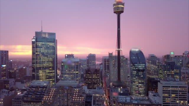 vidéos et rushes de aerial pan down: sydney city at night, city lights on buildings, sydney, australia - sydney