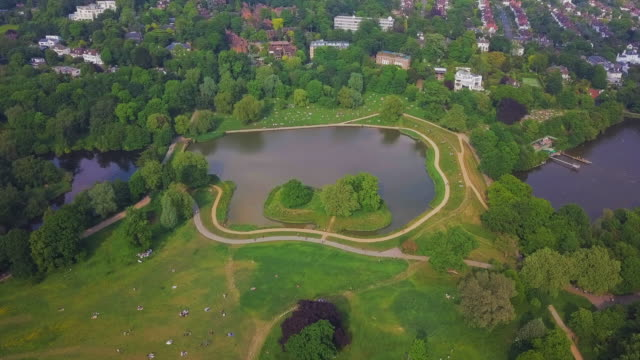 aerial pan forward: water in the london park - pond stock videos & royalty-free footage