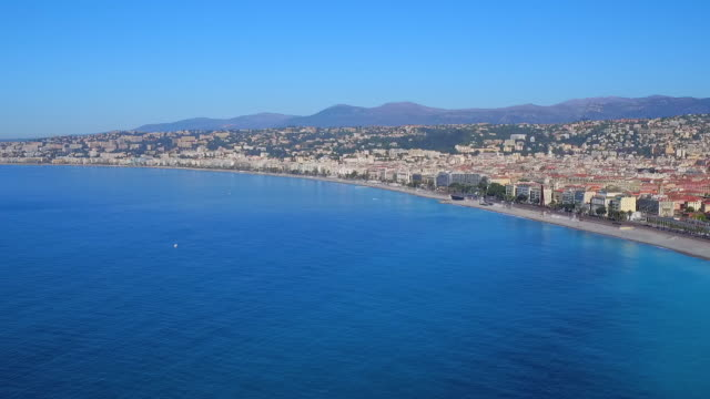 aerial pan: french riviera and the architecture of nice - ヤシ点の映像素材/bロール
