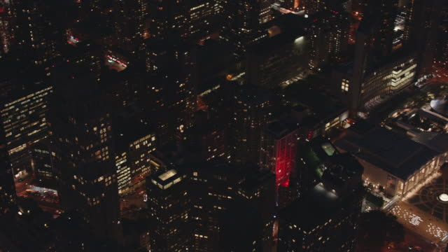 aerial pan from lincoln center in manhattan to columbus circle at night with lights of buildings and traffic - upper west side manhattan stock videos and b-roll footage