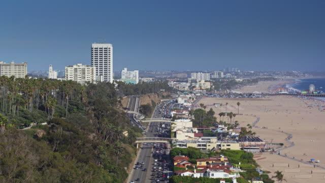 aerial pan from santa monica pier to palisades park - palisades park stock videos & royalty-free footage