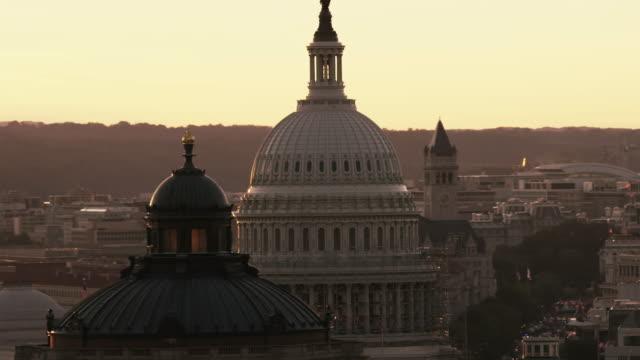 Aerial pan left on United States Capitol Building, Sunset, Washington D.C.