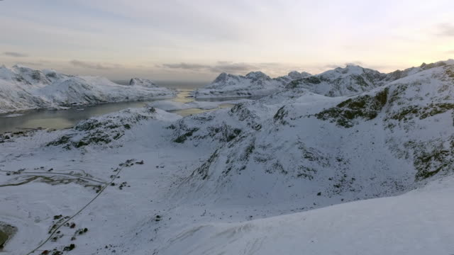 aerial pan left to right: mountains separated by the waters of lofoten norway - lofoten, norway - nordland county stock videos & royalty-free footage