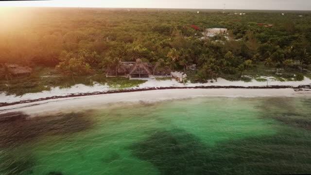 vídeos y material grabado en eventos de stock de aerial pan left to right: old abandoned architectures in mexico - playa del carmen