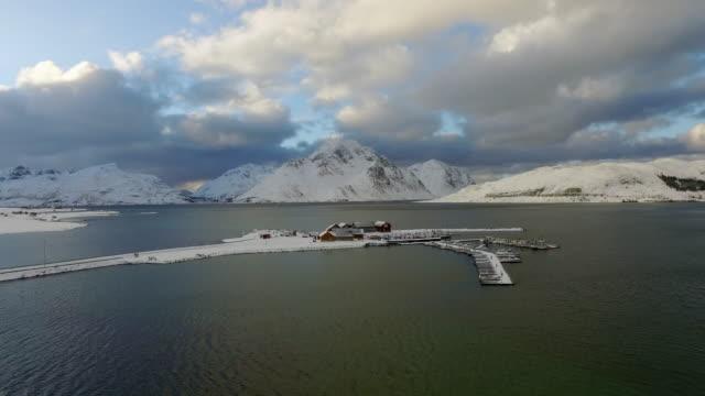 aerial pan left to right: travelling through the lake of lofoten norway - lofoten, norway - nordland county stock videos & royalty-free footage