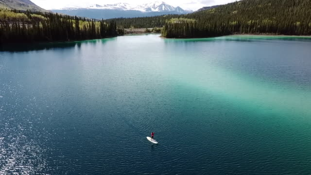 aerial pan left to right: traversing the lake - awe stock videos & royalty-free footage