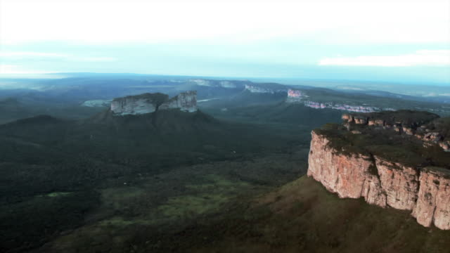 aerial pan: lush green valley among stunning mountains in chapada, brazil - rock type stock videos and b-roll footage